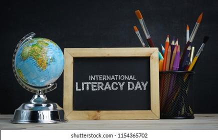 International Literacy Day. World Globe, School Stationary and Alarm Clock