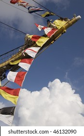 International maritime signal flags on bowsprit of tall ship in Bermuda
