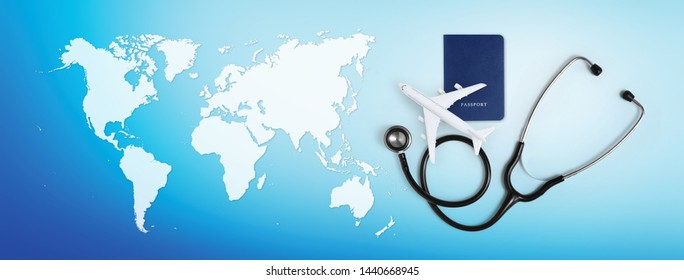 international medical travel insurance concept, stethoscope, passport and airplane on blue background with map