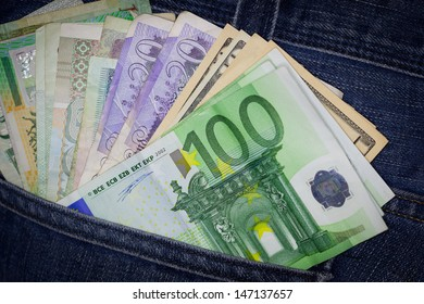 International money in blue jeans back pocket