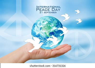 International Peace Day poster.Elements of this image furnished by NASA