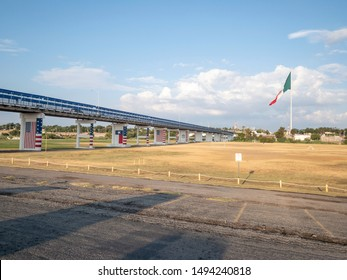 International port of entry in Eagle Pass, TX. Largest Mexican flag flying in the background in Piedras Negras, CO.