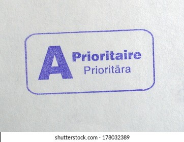 International priority mail postmark on a letter envelope written in French and Latvian