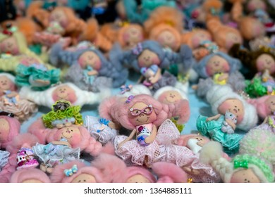 """The XІХ International Puppet Exhibition """"Fashion Doll"""", Ukraine, Kiev, from April 5 to April 7, 2019. Handmade miniature dolls.  Focus in the center."""