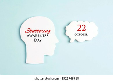 International Stuttering Awareness day, 22 October. Face profile silhouette with speech bubble on a blue background. Greeting message concept.