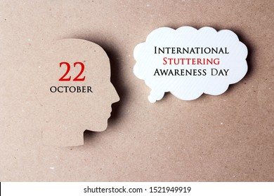 International Stuttering Awareness day, 22 October. Face profile silhouette with speech bubble on a paper brown background. Greeting message concept.