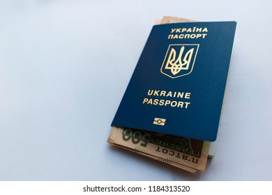 International Ukrainian passport with hryvnias. Ukrainian money, documents, stamp and passport on the white background with space for text