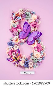 International Women's Day. Banner, flyer, beautiful postcard for March 8. Flowers and butterflies in the shape of the number eight on a pink background. - Shutterstock ID 1901992909