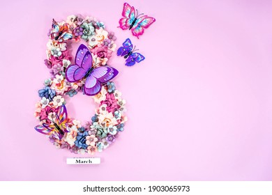 International Women's Day. Banner, flyer, beautiful postcard for March 8. Flowers and butterflies in the shape of the number eight on a pink background.