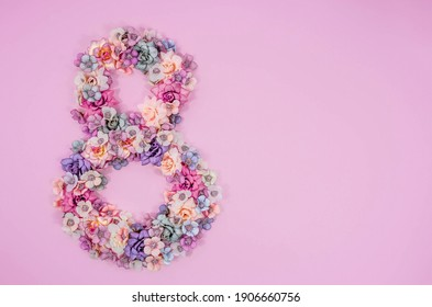 International Women's Day. Banner, flyer, beautiful postcard for March 8. Flowers in the shape of the number 8 on a pink background.