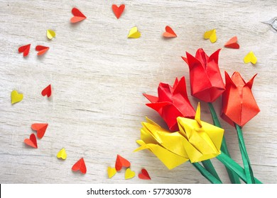 International Women's Day, tulips paper origami confetti on the wooden table