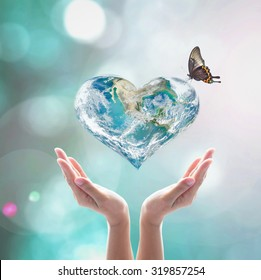 International women's heart health day concept with world heart with butterfly : Elements of this image furnished by NASA