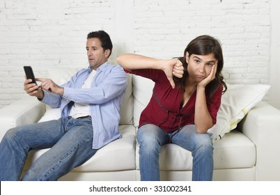 internet addict man using compulsively mobile phone ignoring wife or girlfriend upset and angry feeling alone in social network addiction and on line communication abuse concept