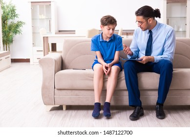 Internet addicted boy visiting male doctor