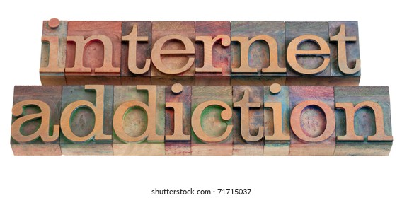 internet addiction phrase in vintage wooden letterpress printing blocks, stained by color inks, isolated on white