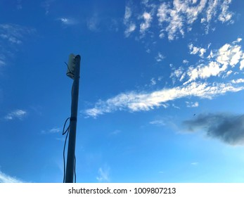 Internet antenna with blue sky with dark cloud mixed with white cloud