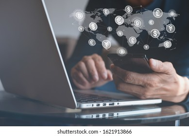 Internet banking, online transaction application, financial technology Fintech concept. Man using mobile smart phone for digital payment with world currency icons on virtual screen