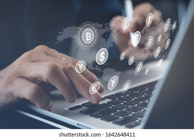 Internet banking, online transaction application, financial technology Fintech concept. Man using laptop computer for digital payment with world currency icons on virtual screen