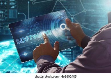 Internet. Business. Technology concept.Businessman presses a button Software on the virtual screen tablet future date.