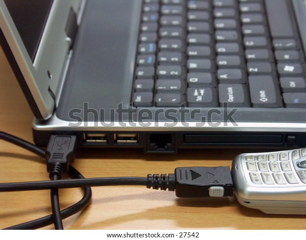 """""""Internet with CDMA Modem"""". A CDMA handphone/mobile as modem, connected  to the laptop/notebook via USB cable"""