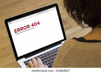 internet concept: error 404 on a laptop screen. Screen graphics are made up.