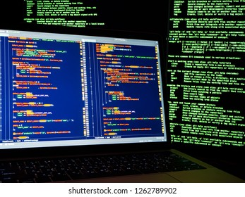 Internet crime concept. Hacker working on a code on dark digital background with digital interface around. Hacker workplace