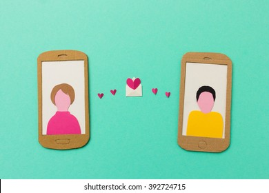Internet dating  - image of woman and man exchanging romantic messages on their mobile phones - useful for mobile dating apps and messaging services
