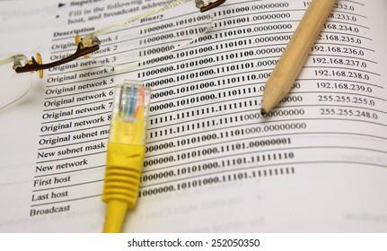 Internet, Ethernet network design: IP address book, wood pencil and Ethernet plug