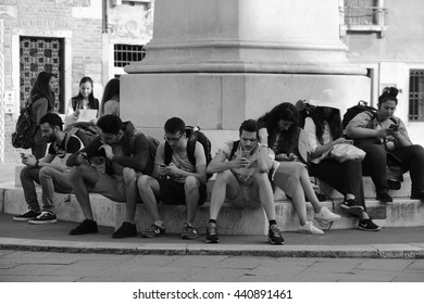 Internet generation, guys in social networks. Venice Italy, May 26, 2016