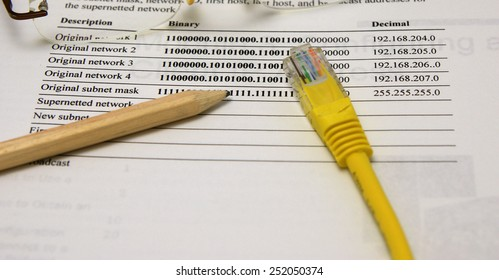 Internet and intranet network scheme: Network map, Ethernet plug, wooden pencil and glasses