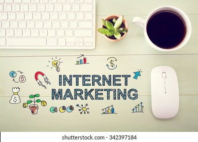 Internet Marketing concept with workstation on a light green wooden desk