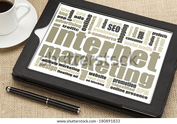 internet marketing - word cloud on a digital tablet with a cup of coffee