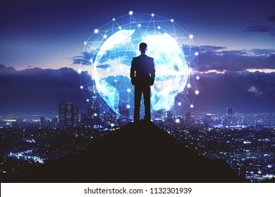 Internet network, global communication and travel business concept with businessman standing on the rock and city view with global network connection.