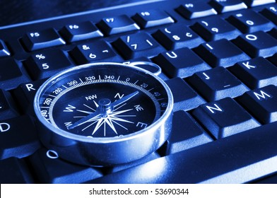 internet or online concept with computer keyboard and compass