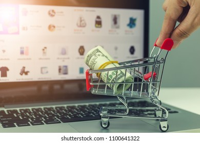 Internet online shopping concept / trolley and the greenback on the tablet.