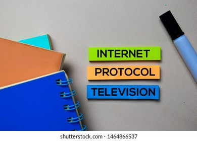 Internet Protocol Television - IPTV text on sticky notes isolated on office desk