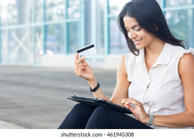 Internet shopping woman online with tablet pc and credit card