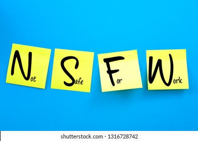 Internet slang, not safe for work or not suitable for workplace concept theme with yellow adhesive stickers spelling out the acronym NSFW attached to a blue background message board