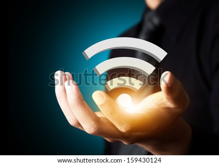 Internet technology and networking concept, Businessman hand with wifi on tablet virtual screen