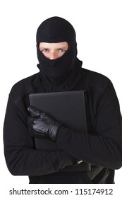 Internet theft - a masked man stealing a laptop.