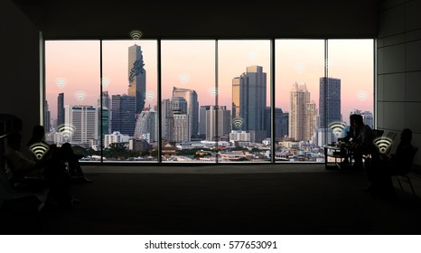 Internet of things concept. Silhouette of window in smart building and smart city view background.