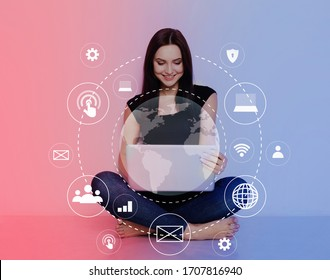 Internet Of Things, Digital Marketing Media In Virtual Screen. Woman using computer with VR icon diagram sitting on floor