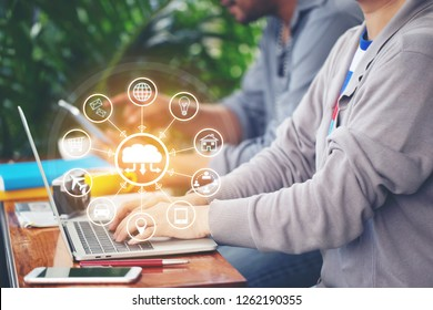 Internet of Things (IoT), Wonman using laptop computer and iot icon or hologram with in coffee shop, Communication network service and Business concept