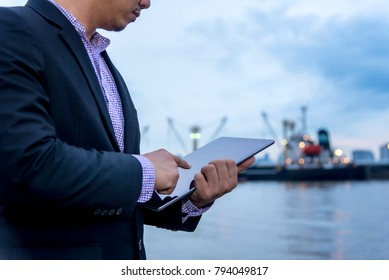 Internet of Things, Smart Businessman use tablet at port import and export shipping