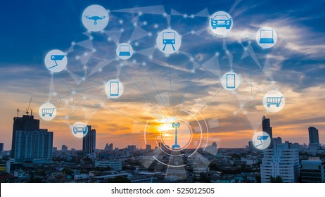 Internet of Things and Smart city concept. Smart things icons mesh on city traffic at twilight background.