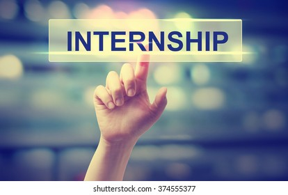 Internship concept with hand pressing a button on blurred abstract background