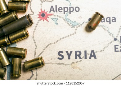 Interpretation on konflikt in Syria. The fired cases and bullets from rifle. Background view on section area of Aleppo, Syria.