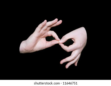 the interpreting sign in sign language on a black background