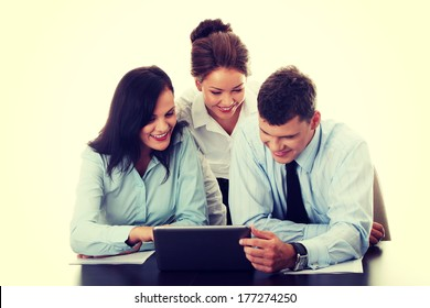 Interracial business team working at laptop in a office, isolated on white