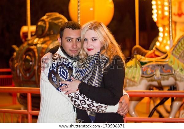 Interracial couple in an amusement park